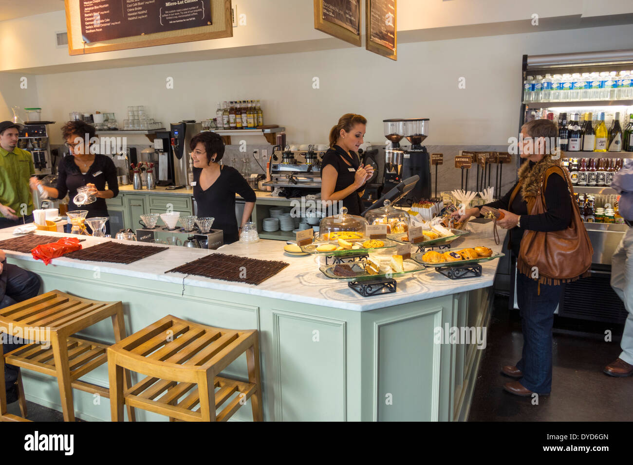Winter Park Florida South Park Avenue Barnie's Coffee Kitchen cafe restaurant inside interior customers counter woman employee coworkers business - Stock Image