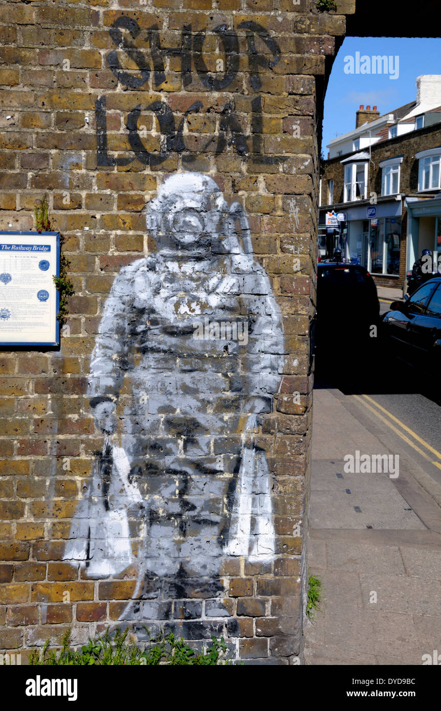 Whitstable, Kent, England, UK. 'Banksy' style graffiti by 'Catman'. Deep sea diver with shopping bags - Stock Image