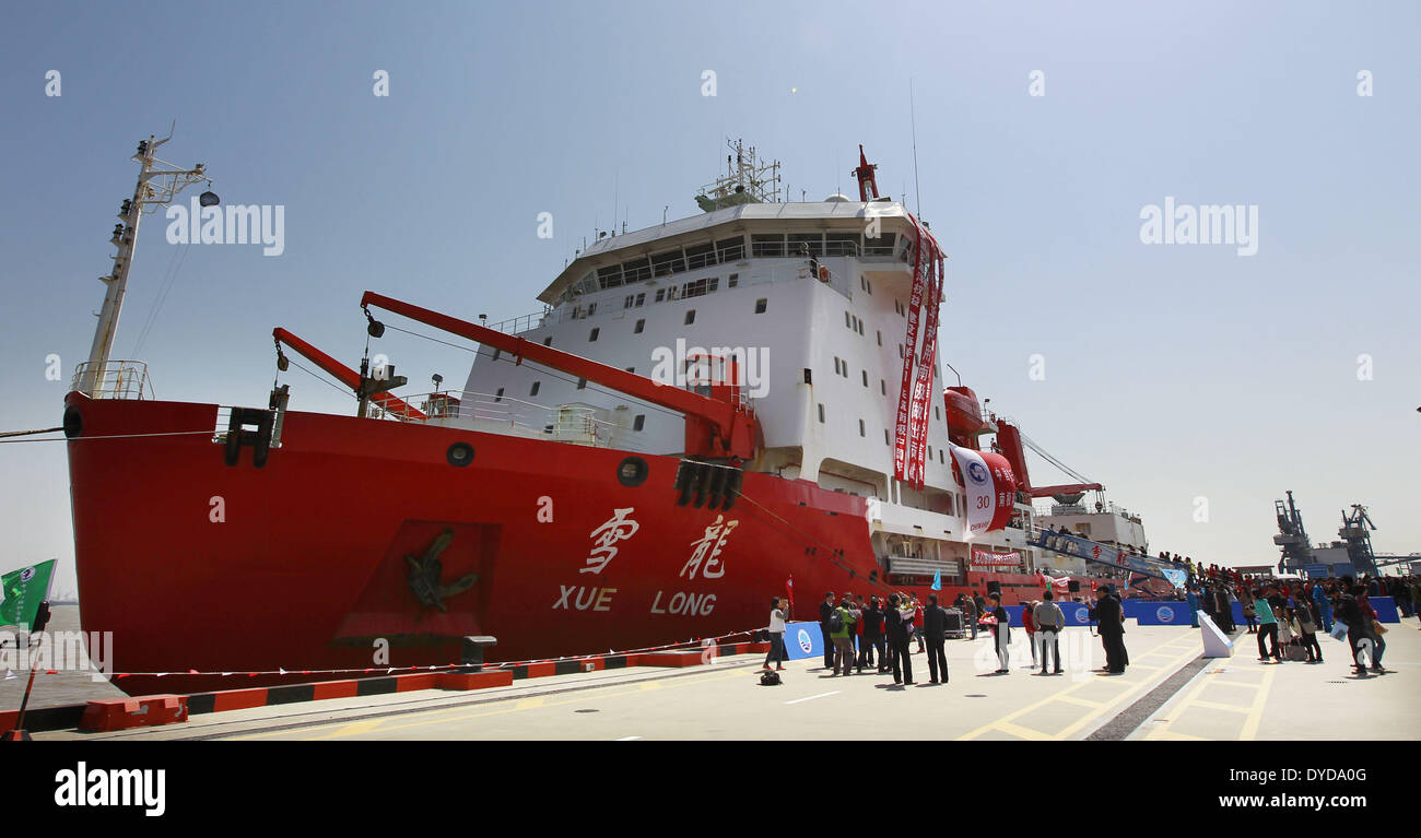 Shanghai, China. 15th Apr, 2014. Chinese research vessel and icebreaker Xuelong (Snow Dragon) is anchored at a dock in Shanghai, east China, April 15, 2014. The icebreaker returned to Shanghai on Tuesday, concluding the country's 160-day scientific expedition to Antarctica. Credit:  Pei Xin/Xinhua/Alamy Live News - Stock Image