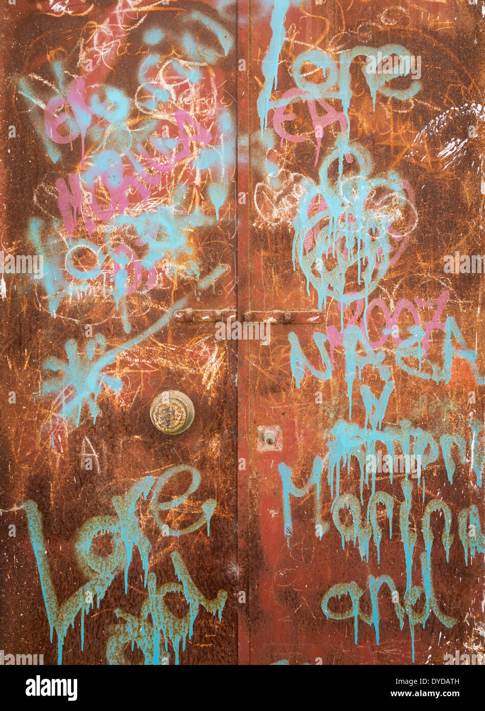 Drawings and writings on a rusty door, Arcos de la Frontera, Cádiz province, Andalusia, Spain - Stock Image
