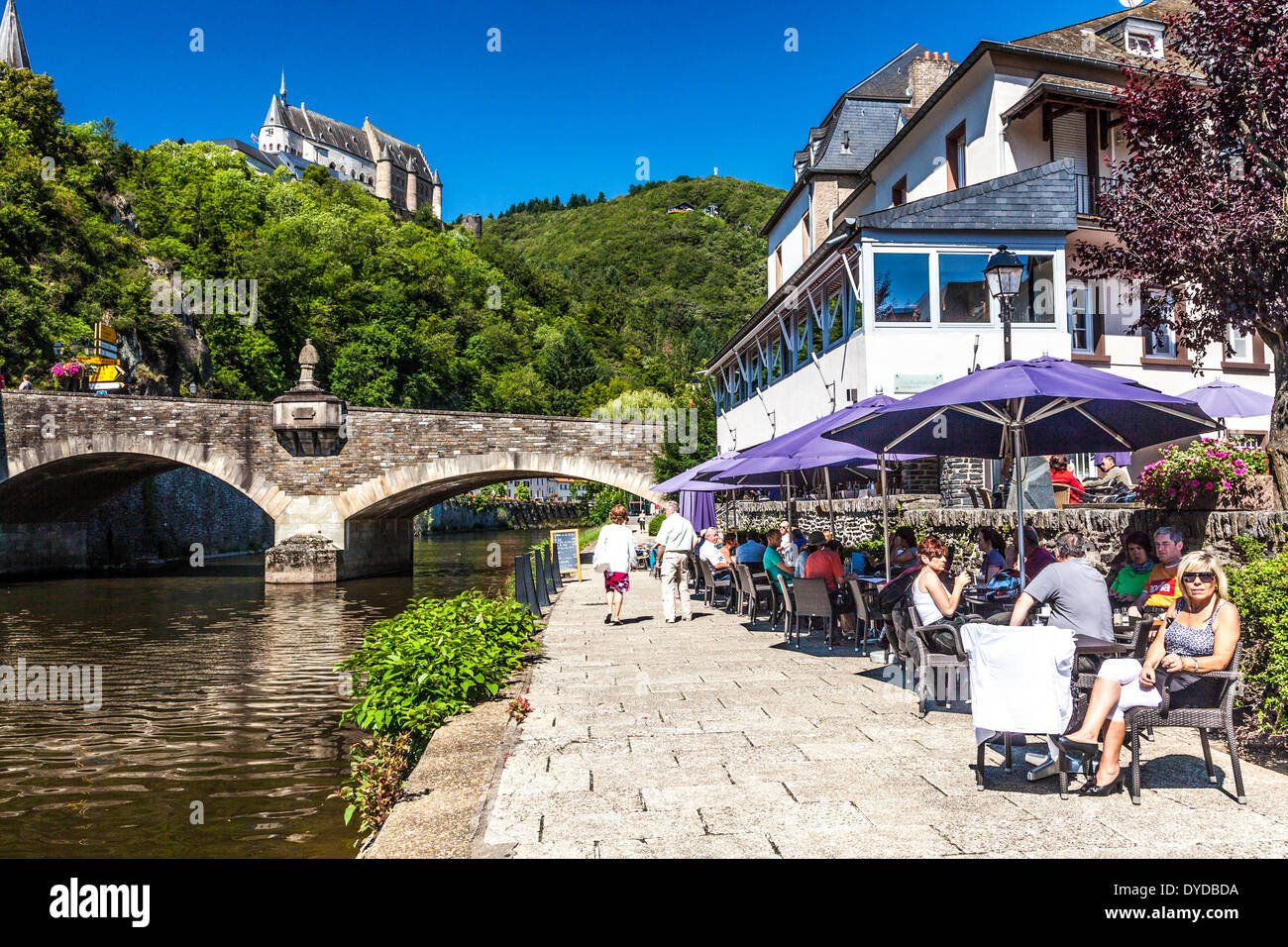 View of the castle at Vianden in Luxembourg from the river Our below. - Stock Image