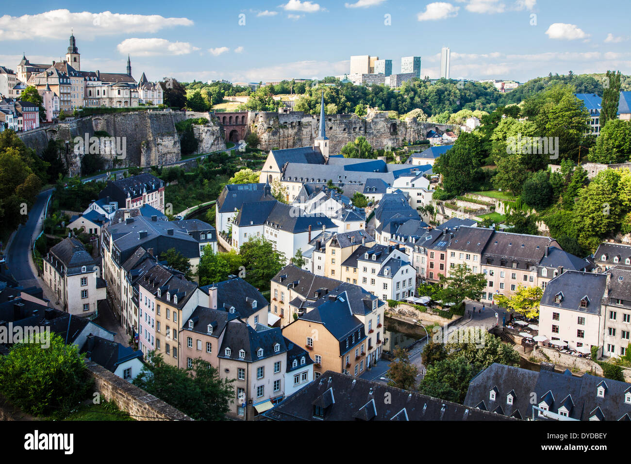 View over the Grund towards the medieval Ville Haute on the left and the modern Kirchberg district of Luxembourg City. - Stock Image