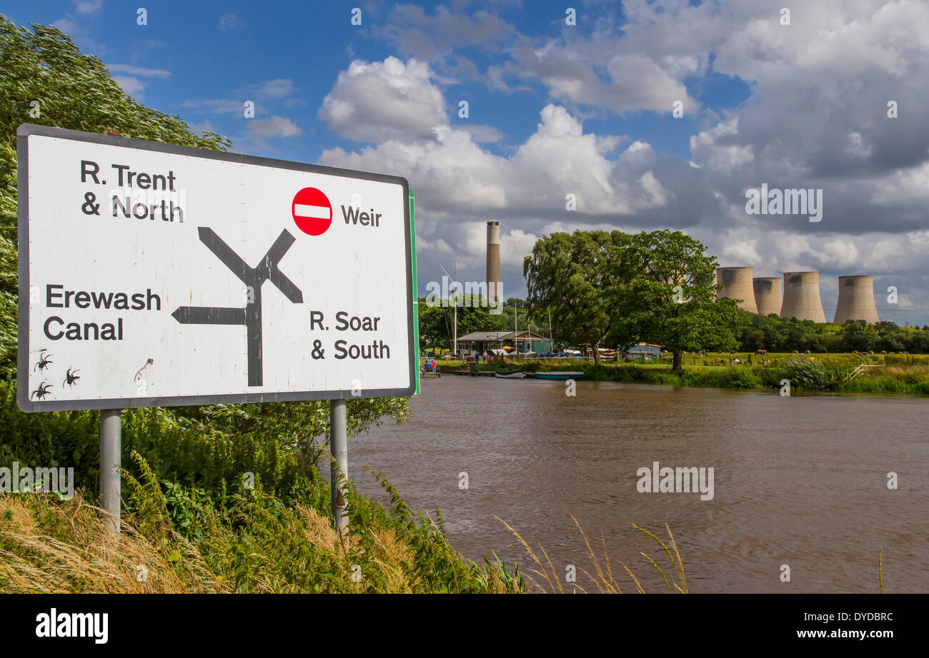 A waterways direction sign at Trent Lock with Ratcliffe on Soar power station in the background. - Stock Image