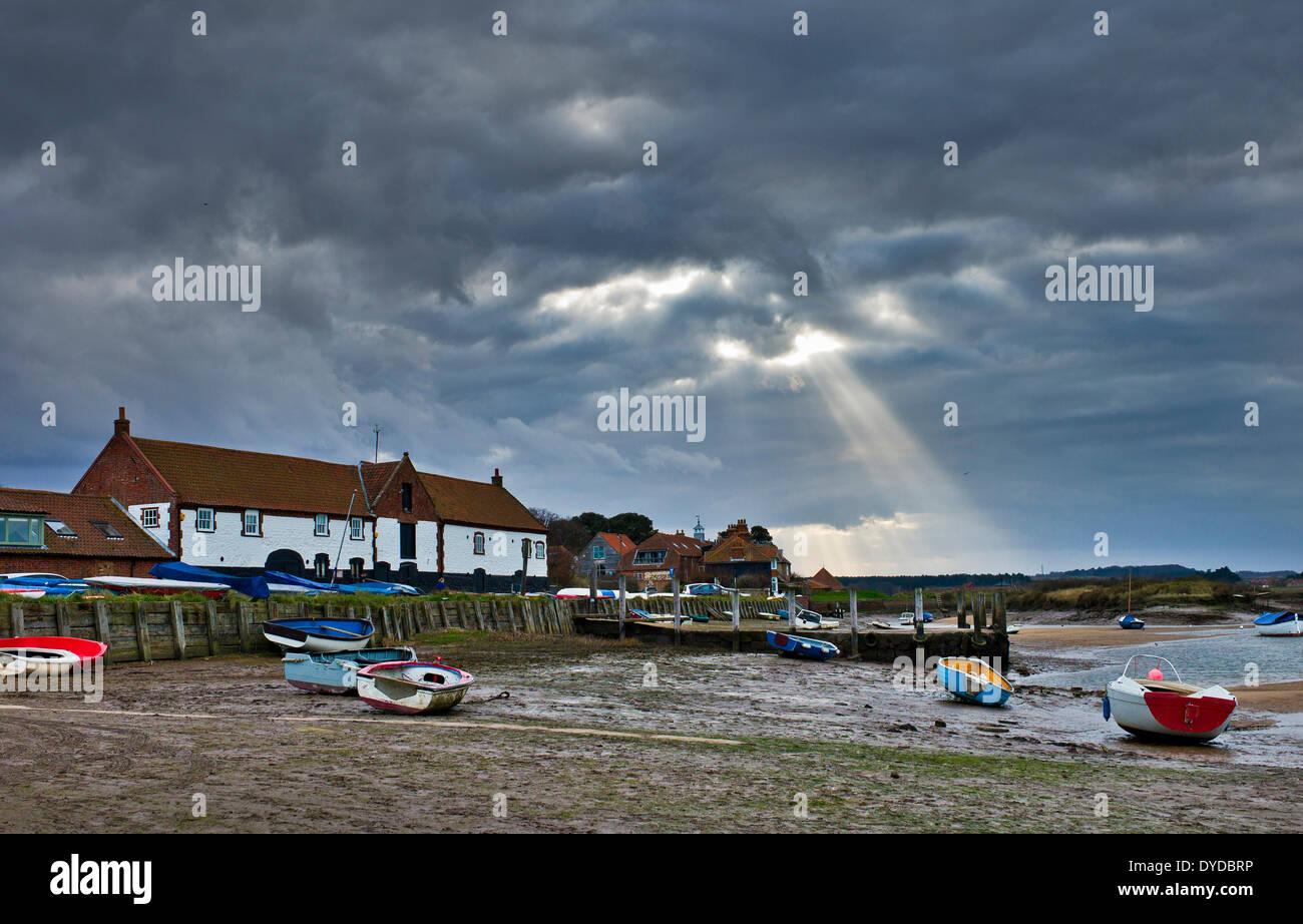 Sun beams over Burnham Overy Staithe. - Stock Image
