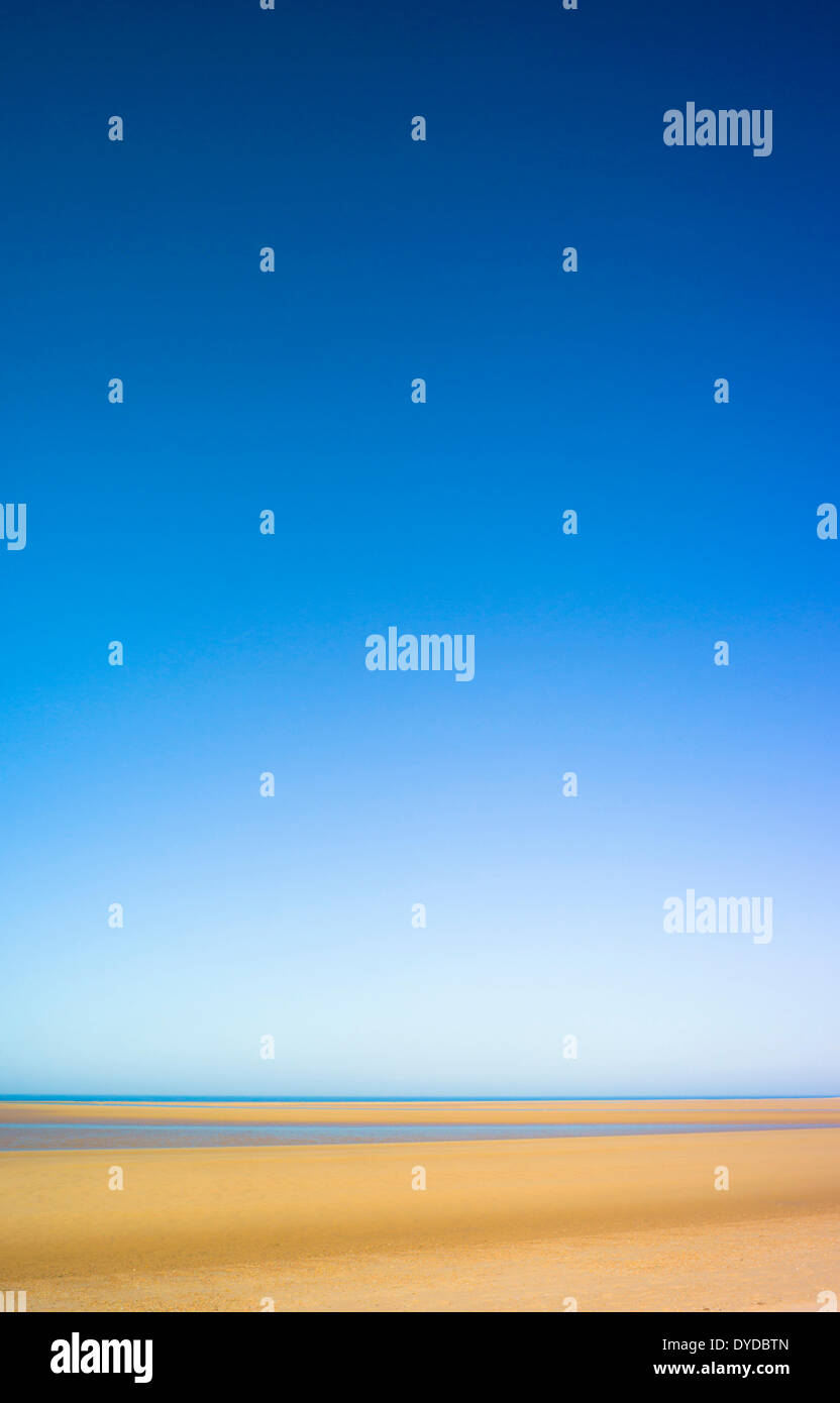 A deserted Norfolk beach. - Stock Image