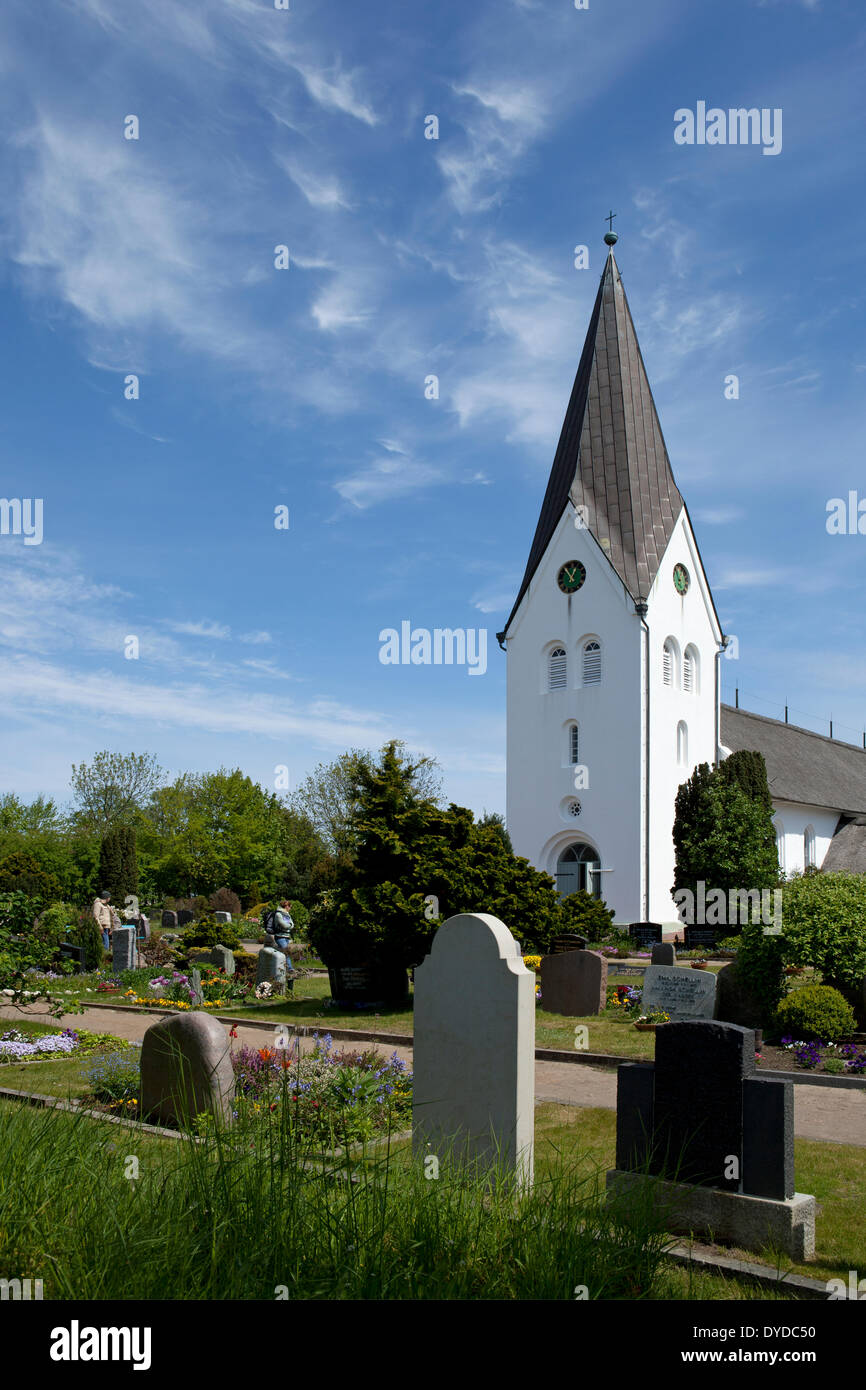 View towards the church in the village of Nebel. - Stock Image
