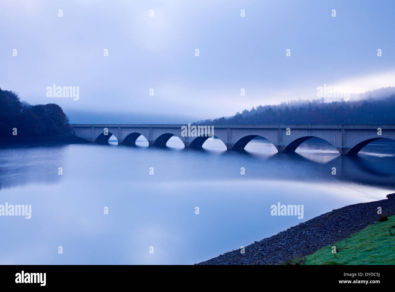 Ashopton Viaduct over Ladybower Reservoir in the Peak District on a foggy morning. Stock Photo