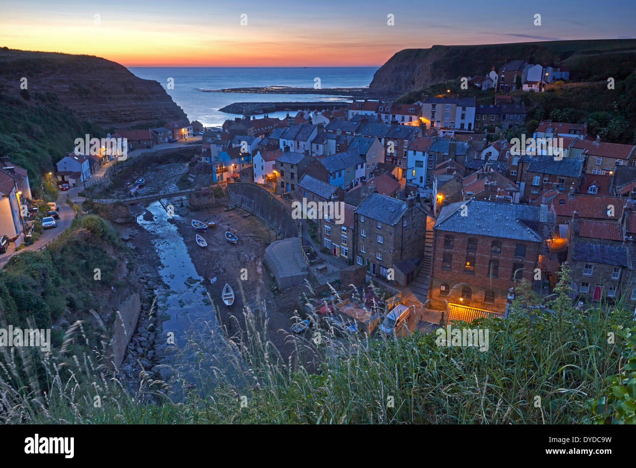 Dawn over the North Sea from Staithes. - Stock Image