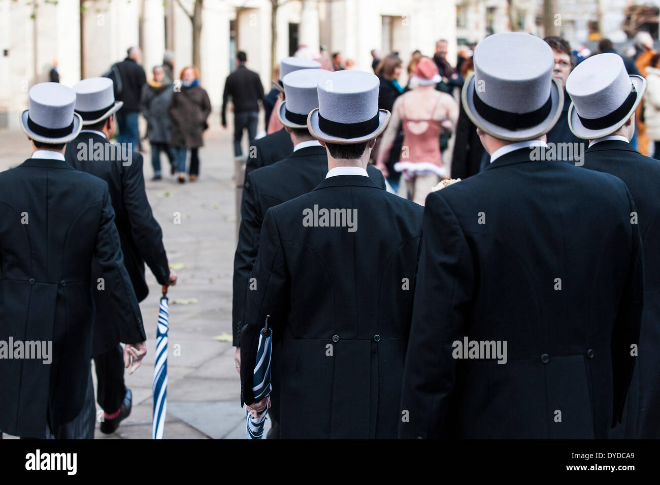 A group of men wearing top hats on their way to a wedding. - Stock Image