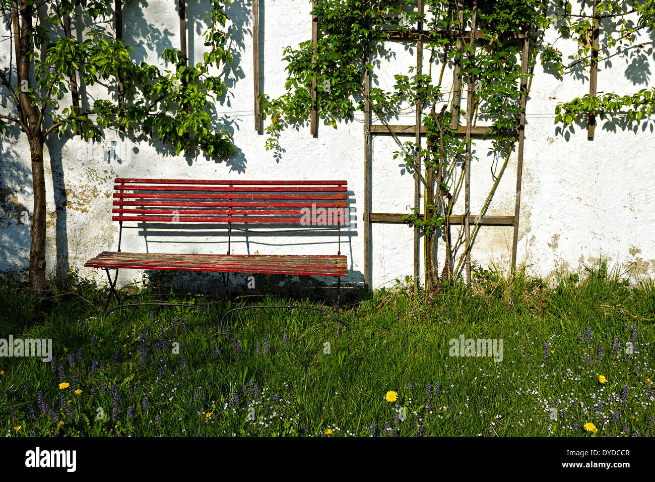Sensational Old Red Wood Bench Seat Against White Wall In Garden Upper Gmtry Best Dining Table And Chair Ideas Images Gmtryco