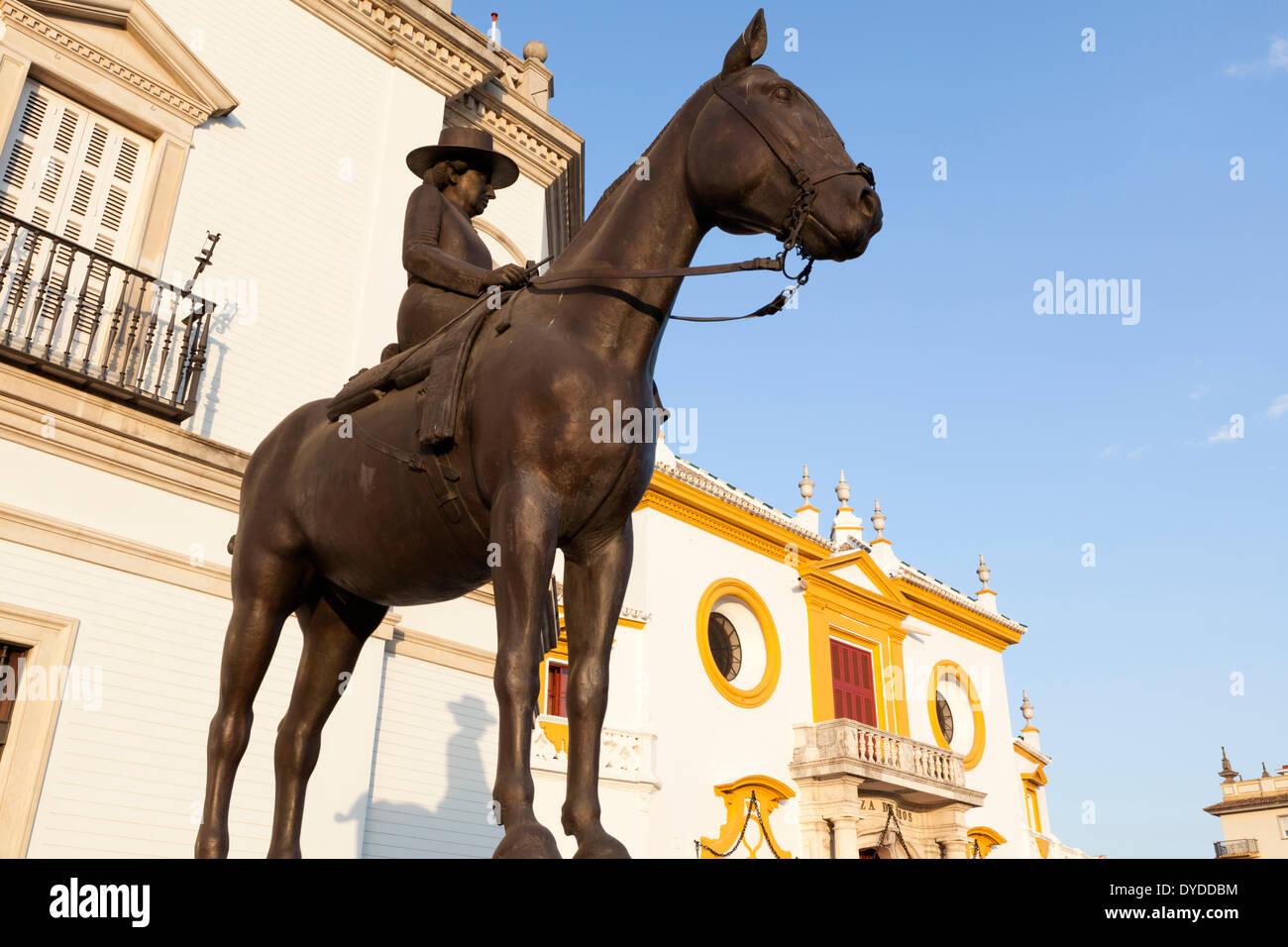Statue of equestrian rider outside the Plaza de toros de la Real Maestranza in Seville. - Stock Image