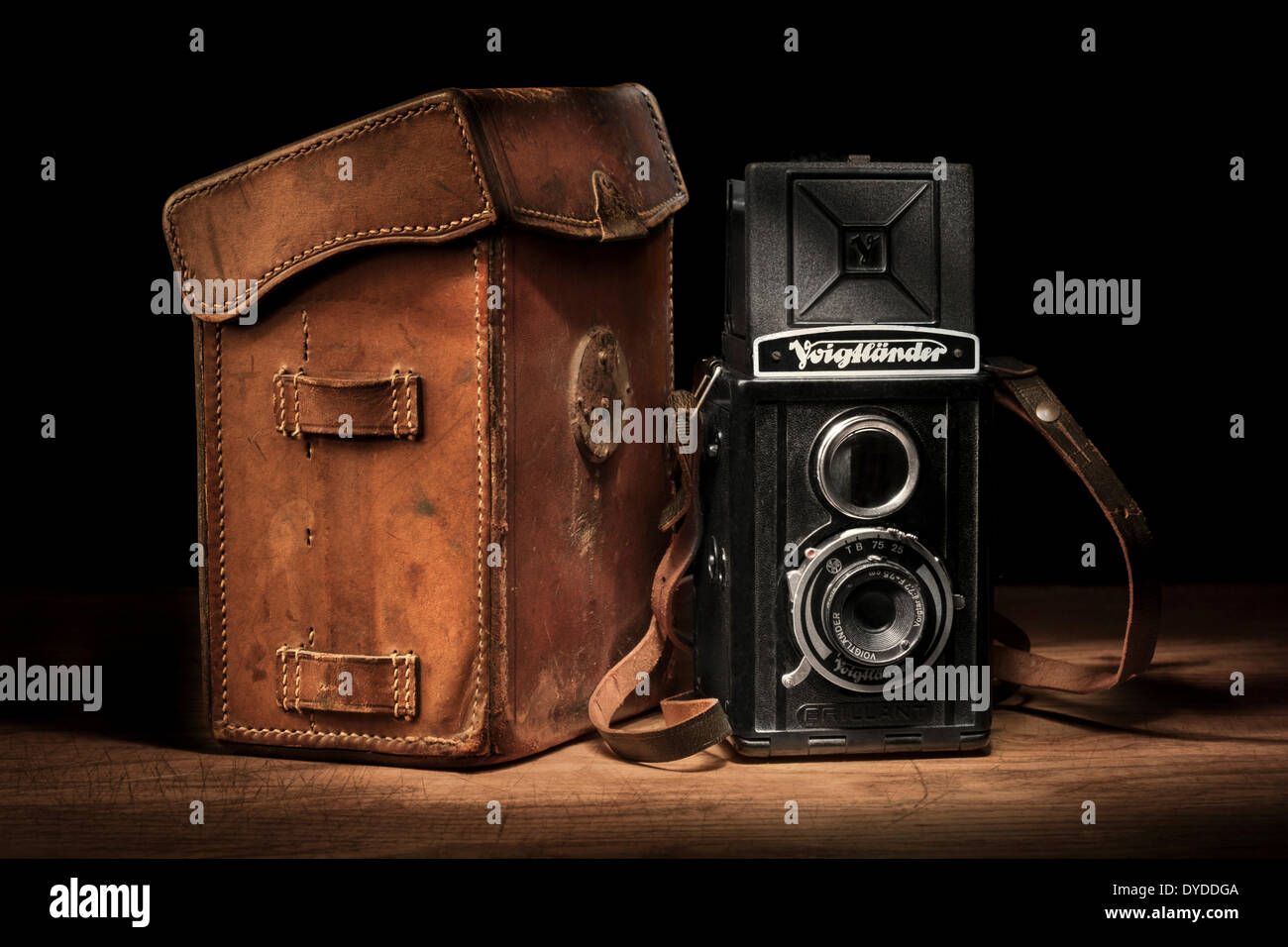 Vintage Voigtlander Brilliant camera with leather case and roll films. - Stock Image