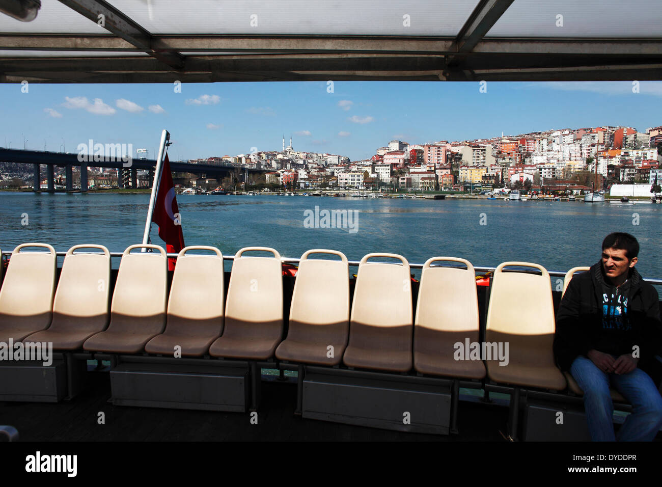 A man inside a ferry boat on the Golden Horn. - Stock Image