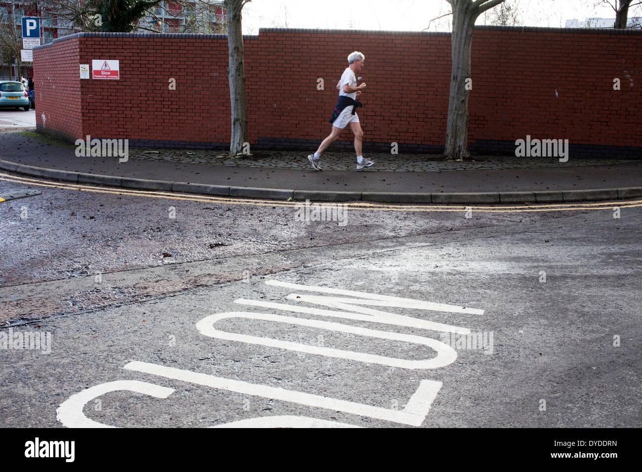 Man jogging in Harbourside. - Stock Image