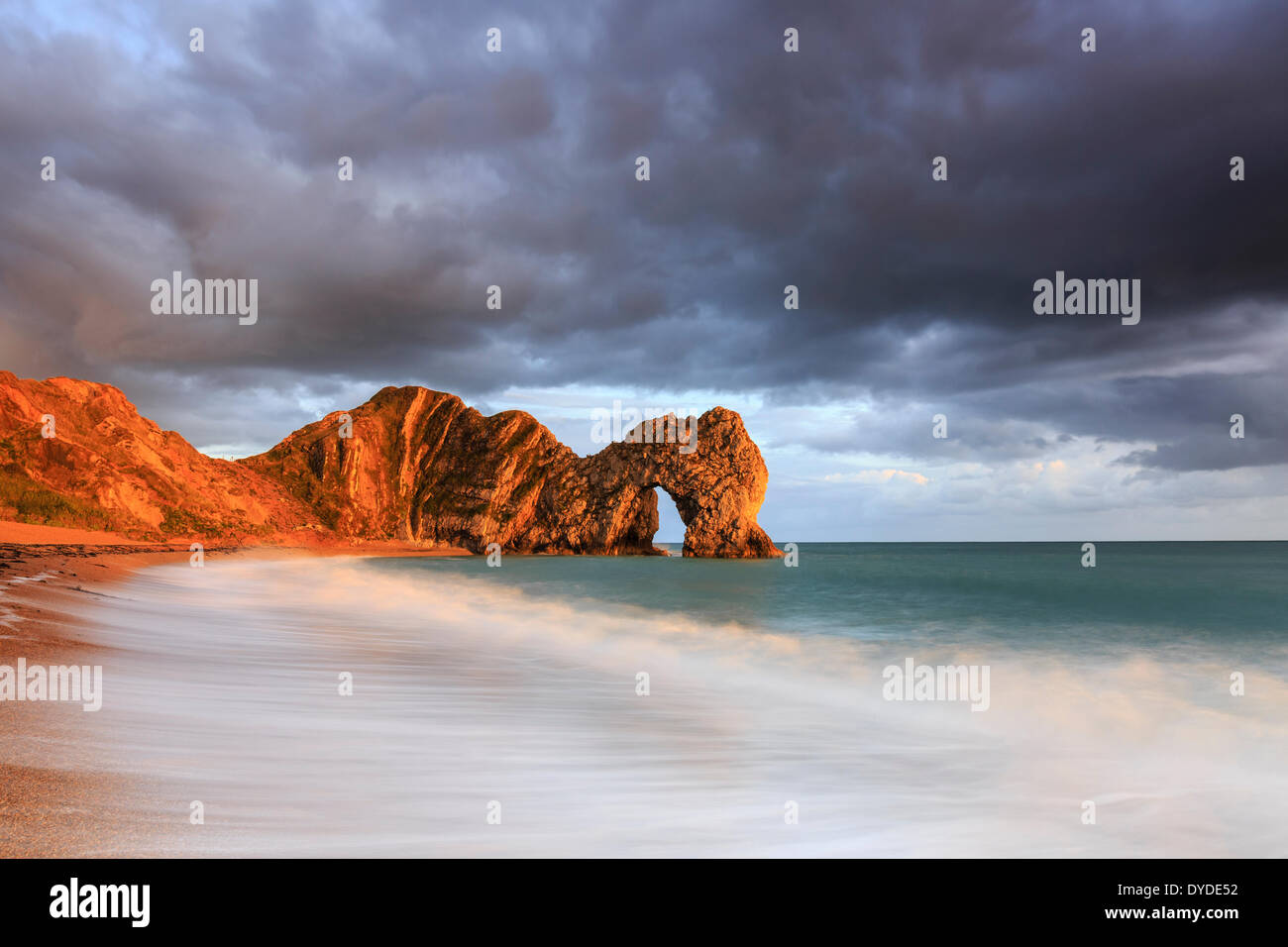 A stormy sunset at Durdle Door in Dorset. - Stock Image