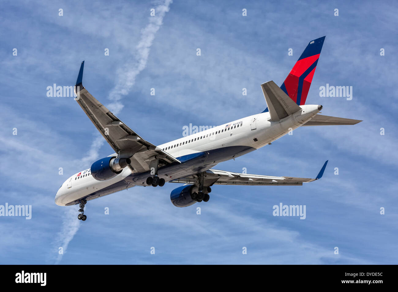 a boeing b757 of delta airlines on final approach stock photo