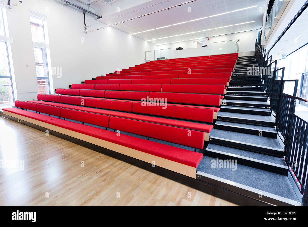 Open retractable seating in the school hall at Notting Hill and Ealing High School. - Stock Image