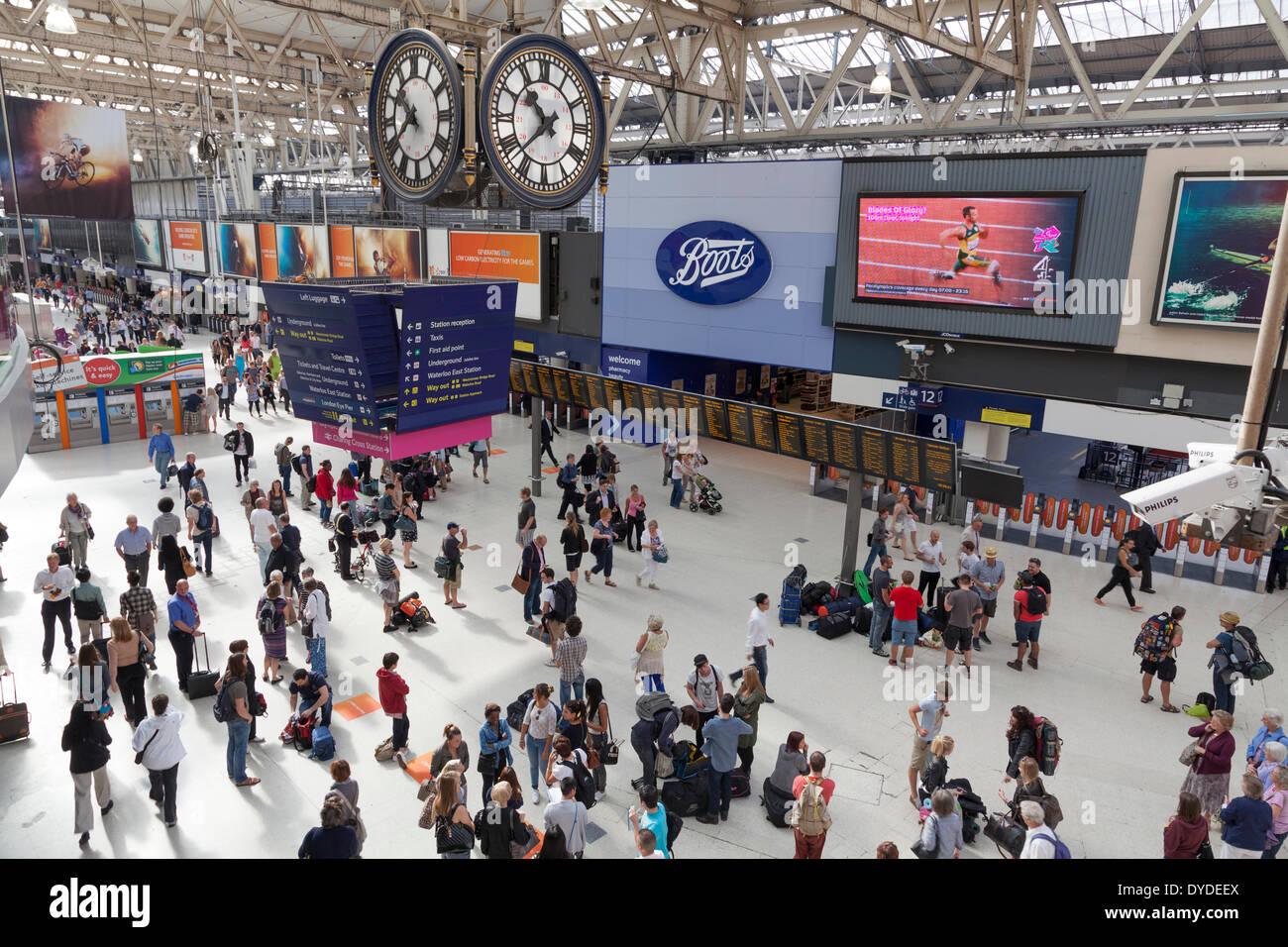 Under the clock at Waterloo Station concourse in London from a high viewpoint. - Stock Image