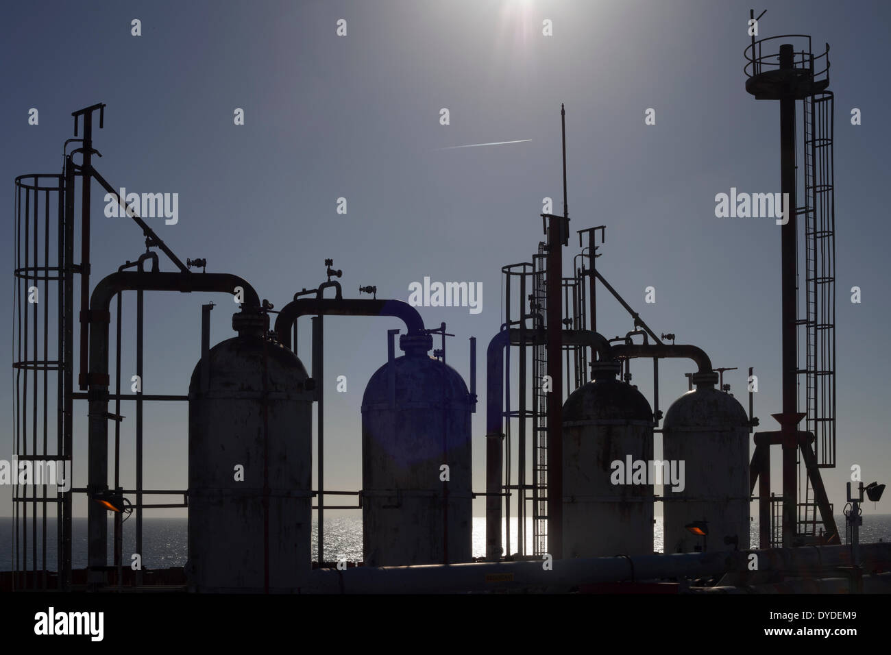 Process pipework on an offshore gas platform. - Stock Image