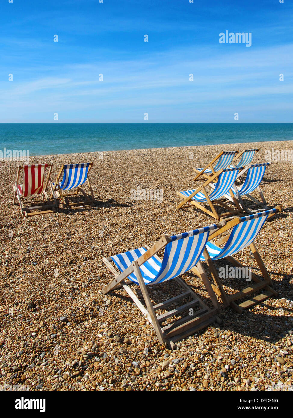 Deck chairs on Brighton beach. - Stock Image