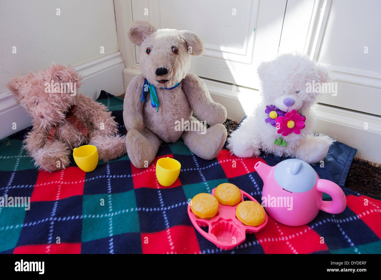 Soft toy set for a childrens teddy bears picnic on a blanket. - Stock Image