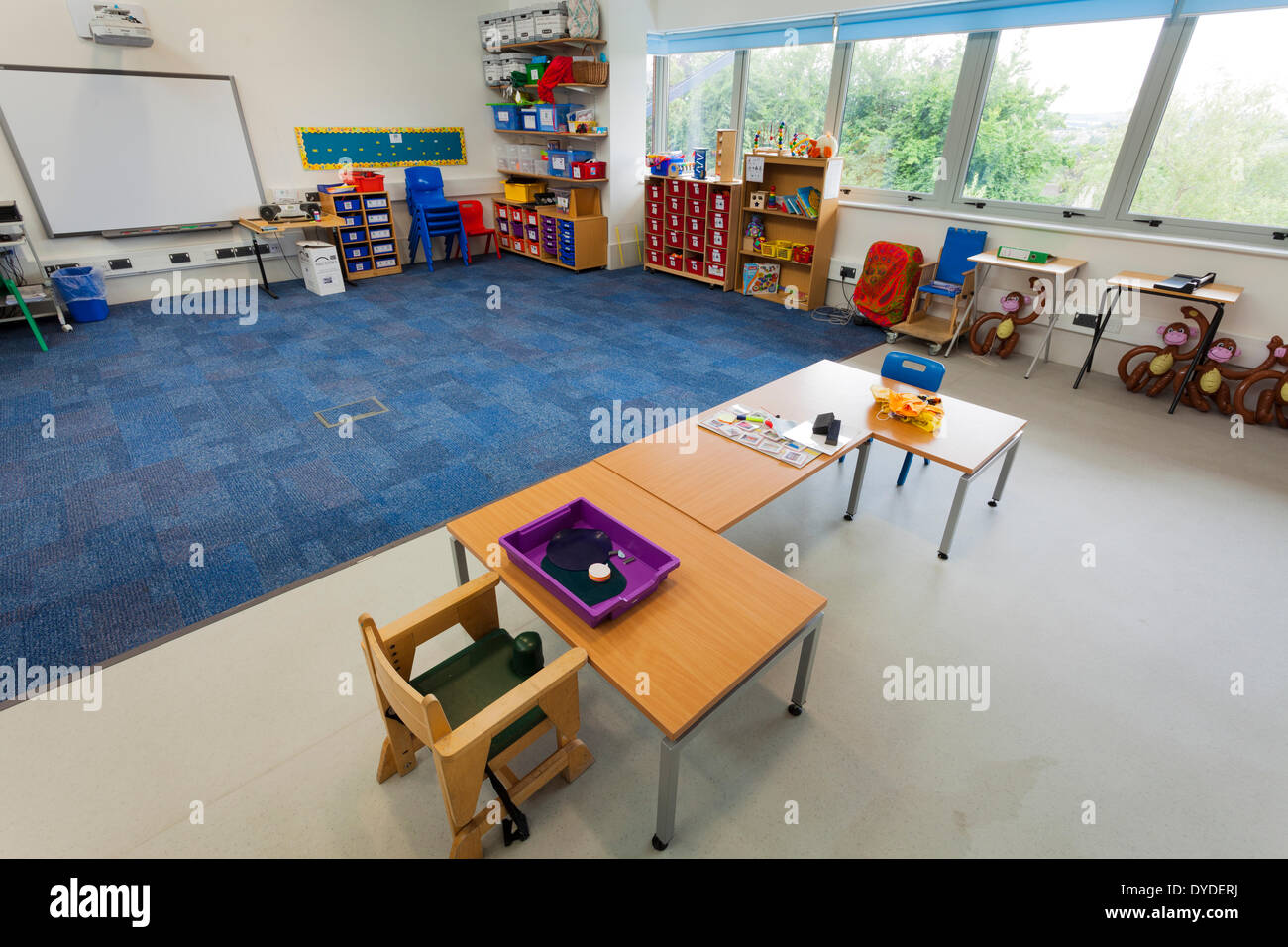 Unoccupied classroom in special needs school. - Stock Image