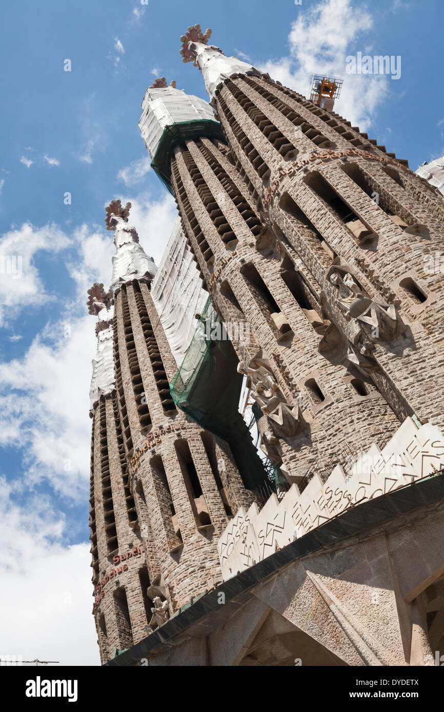 Towers on the passion facade of the exterior of La Sagrada Familia Cathedral. - Stock Image