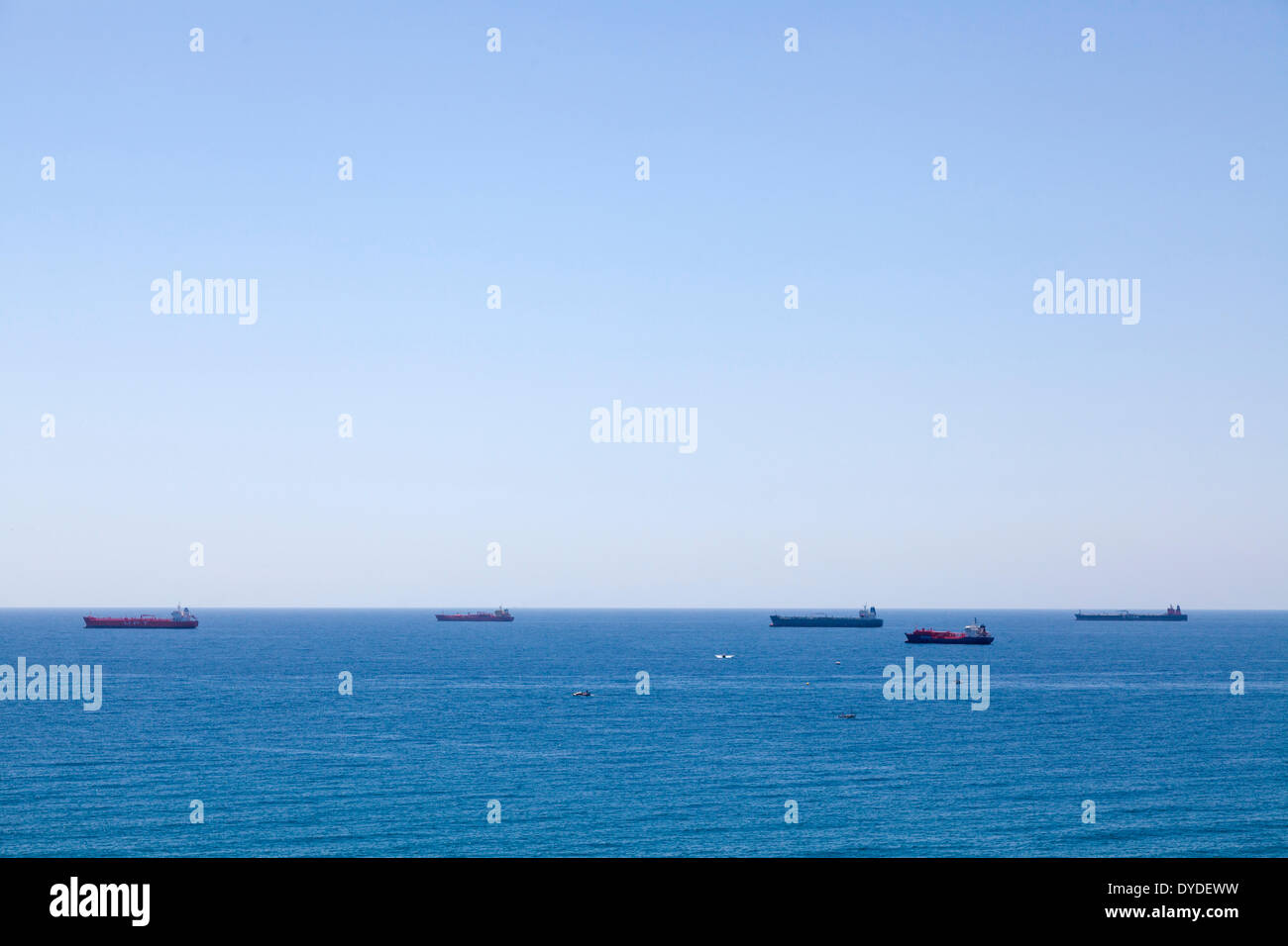Tankers and container ships passing off Tarragona in the Mediterranean. - Stock Image