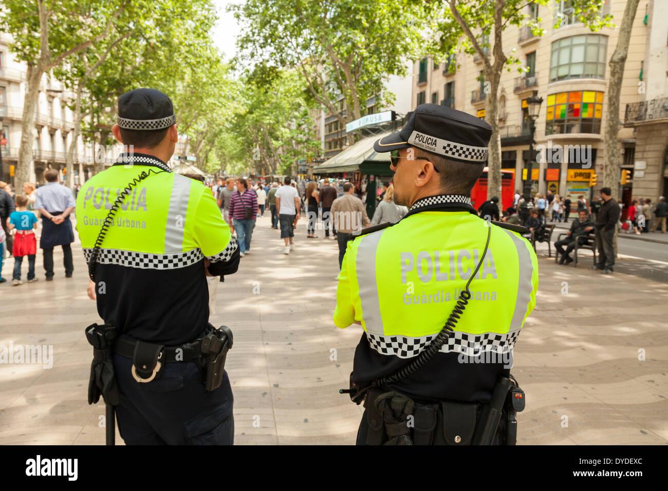 Two Guardia Urbana Policemen policing the La Rambla in Barcelona. - Stock Image