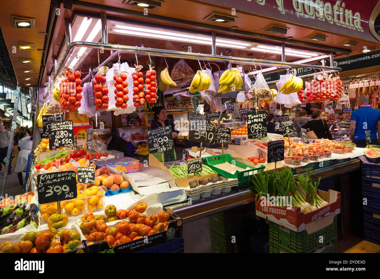 Display of produce on vegetable market stall in La Boqueria Market in Barcelona. - Stock Image