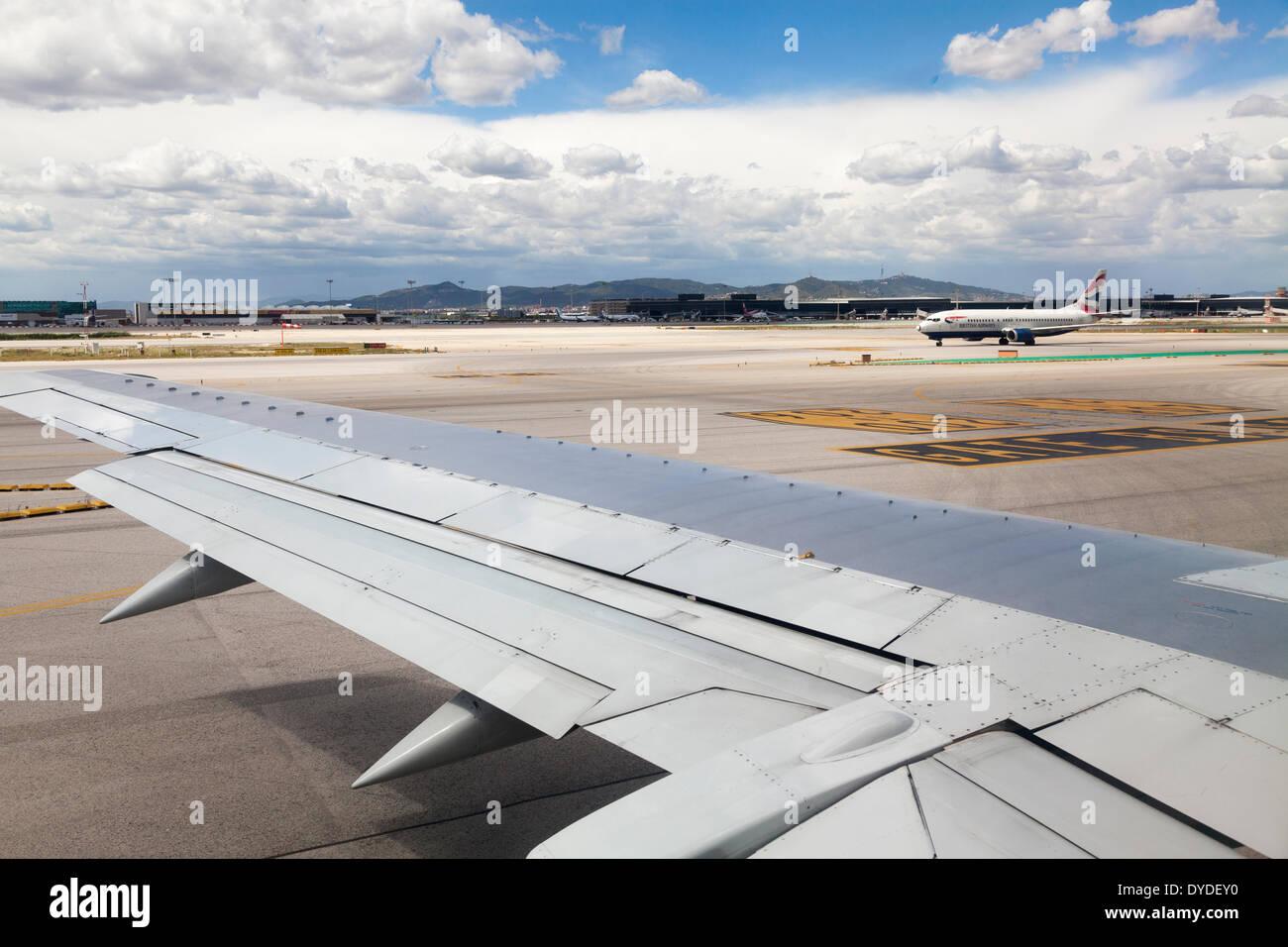 British Airways jet and wing on Barcelona El Prat runway. - Stock Image