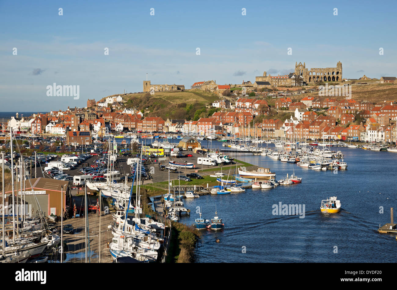 Looking along River Esk towards the harbour at Whitby. - Stock Image