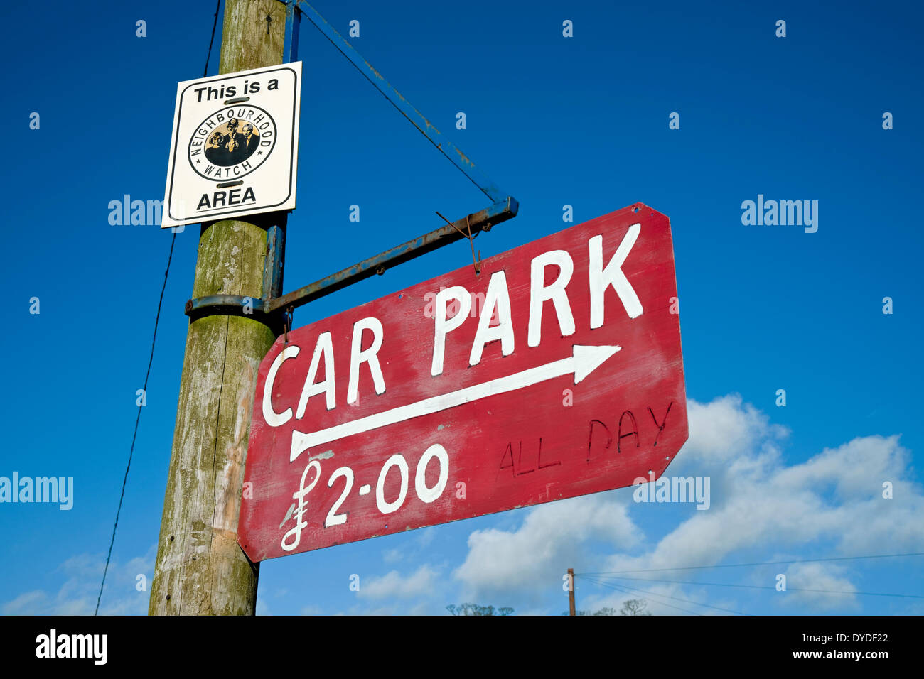 Neighbourhood watch area sign and hand painted all day car parking sign. - Stock Image