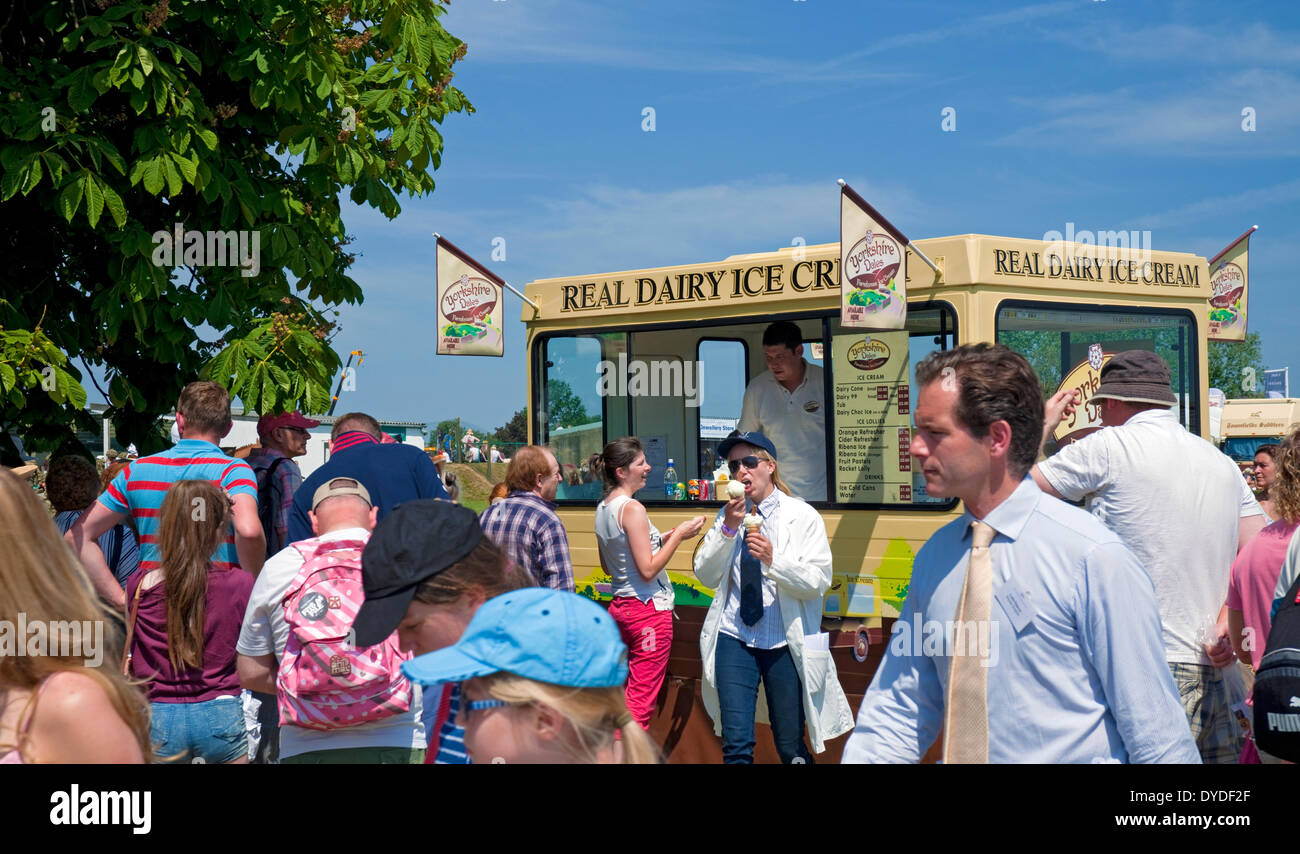 People queueing for ice cream on a hot summer day at the Great Yorkshire Show. - Stock Image