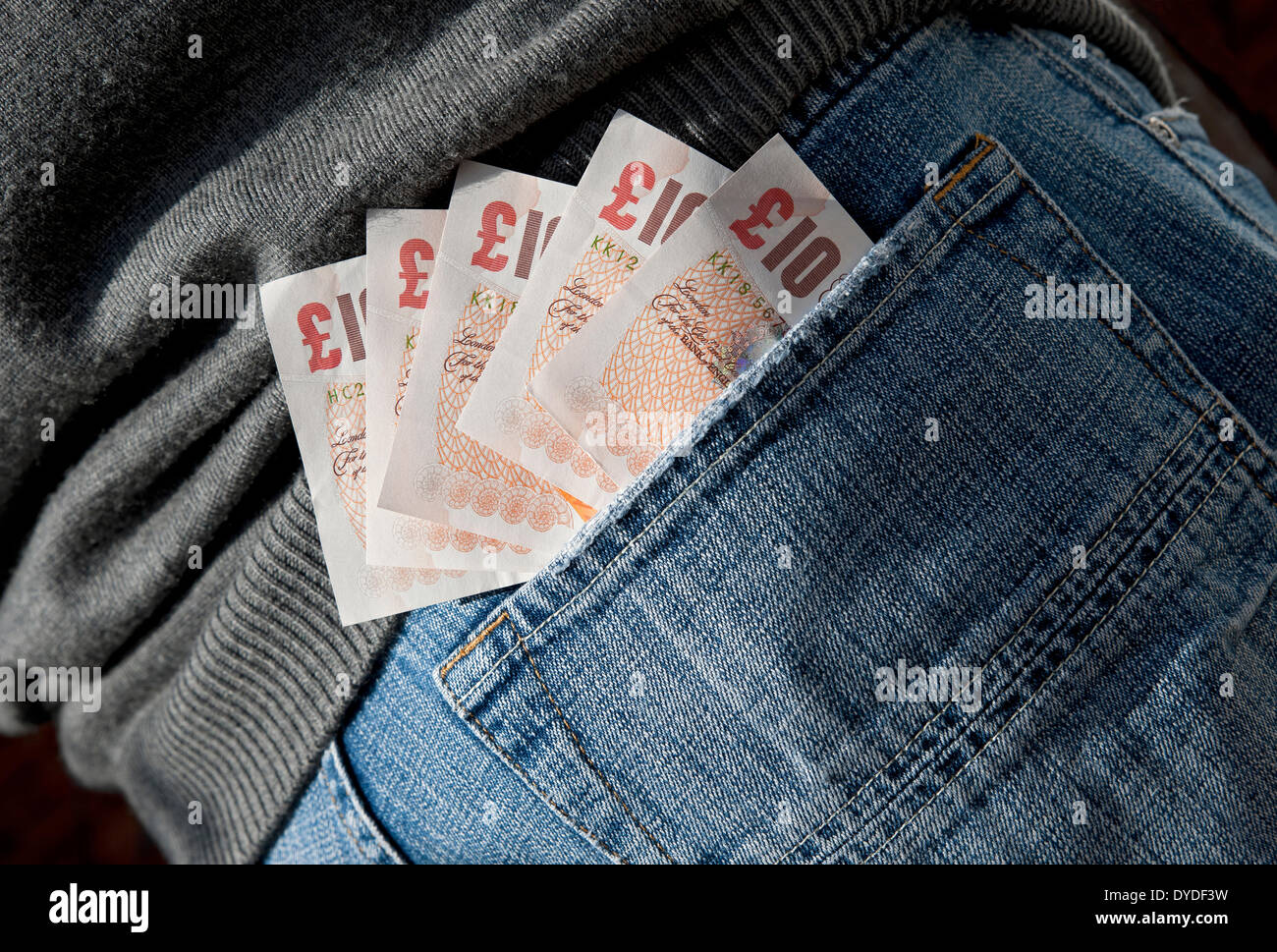English ten pound notes in a back pocket. - Stock Image