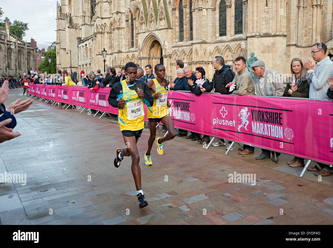 Elite Kenyan athletes John Mutai and John Kales run past York Minster in the first Plusnet Yorkshire Marathon. - Stock Image