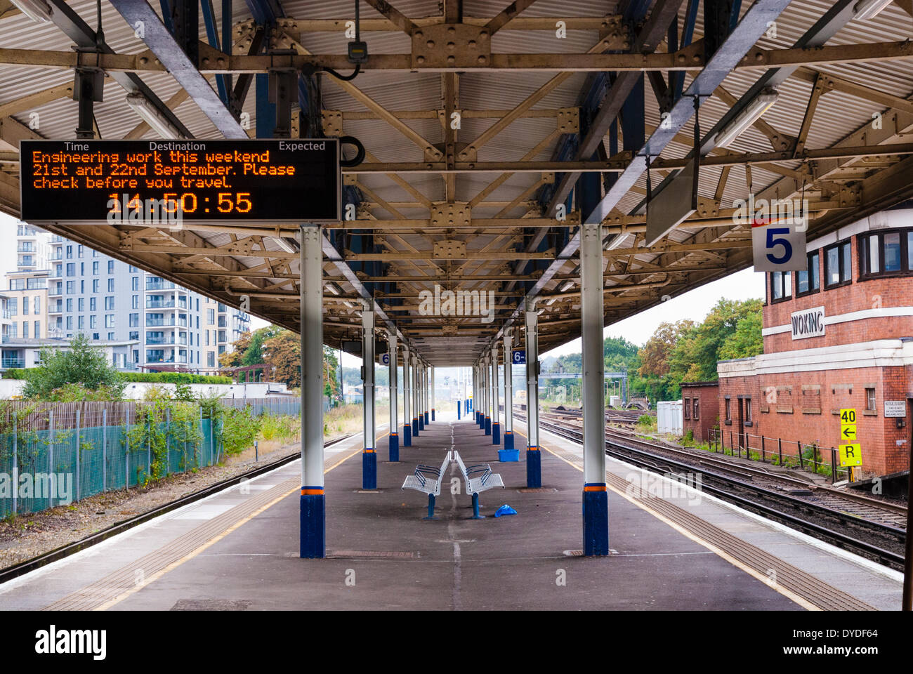 Empty platform at Woking station with engineering work electronic sign. - Stock Image