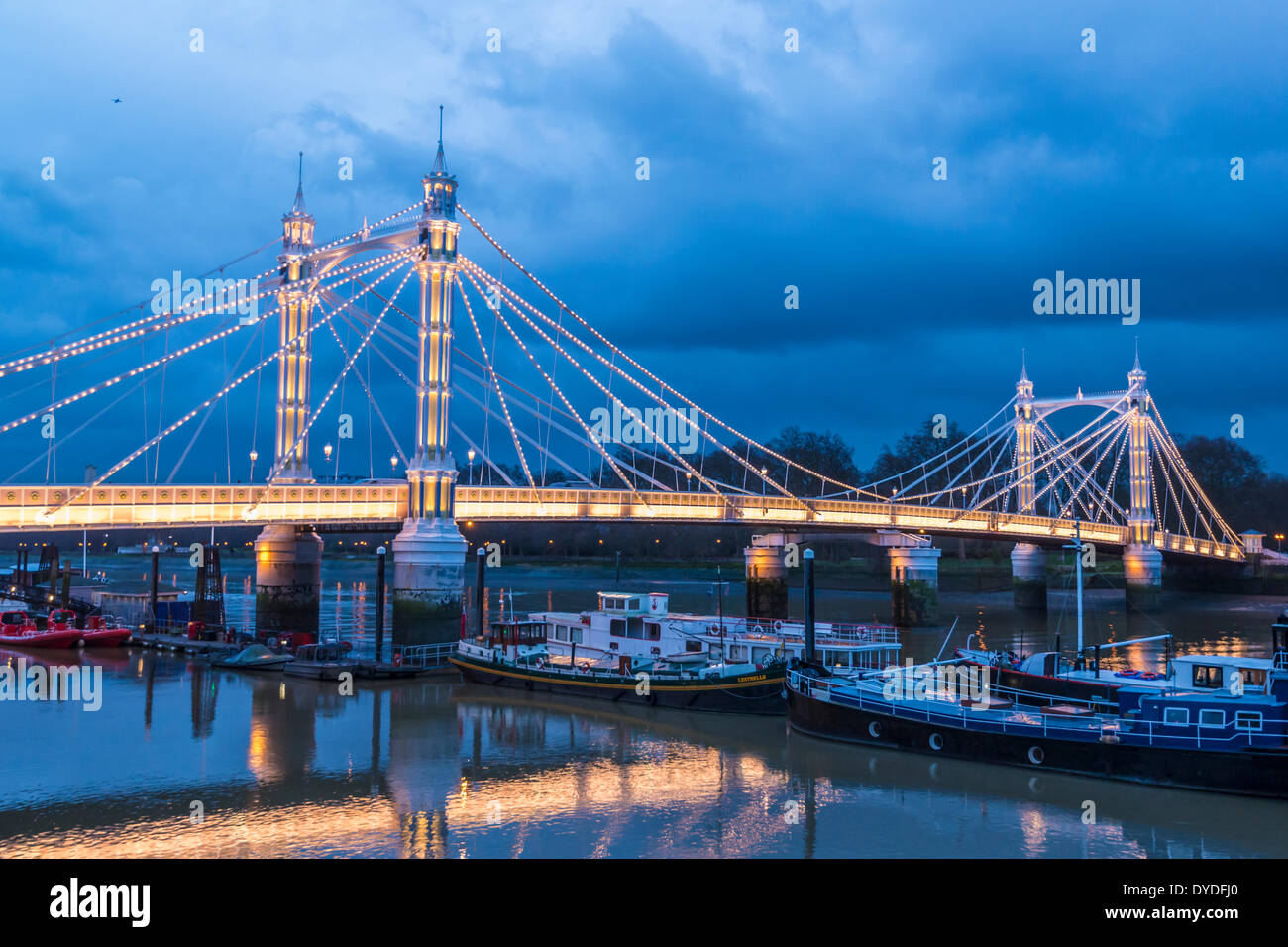 A view of Albert Bridge from Chelsea Embankment. - Stock Image