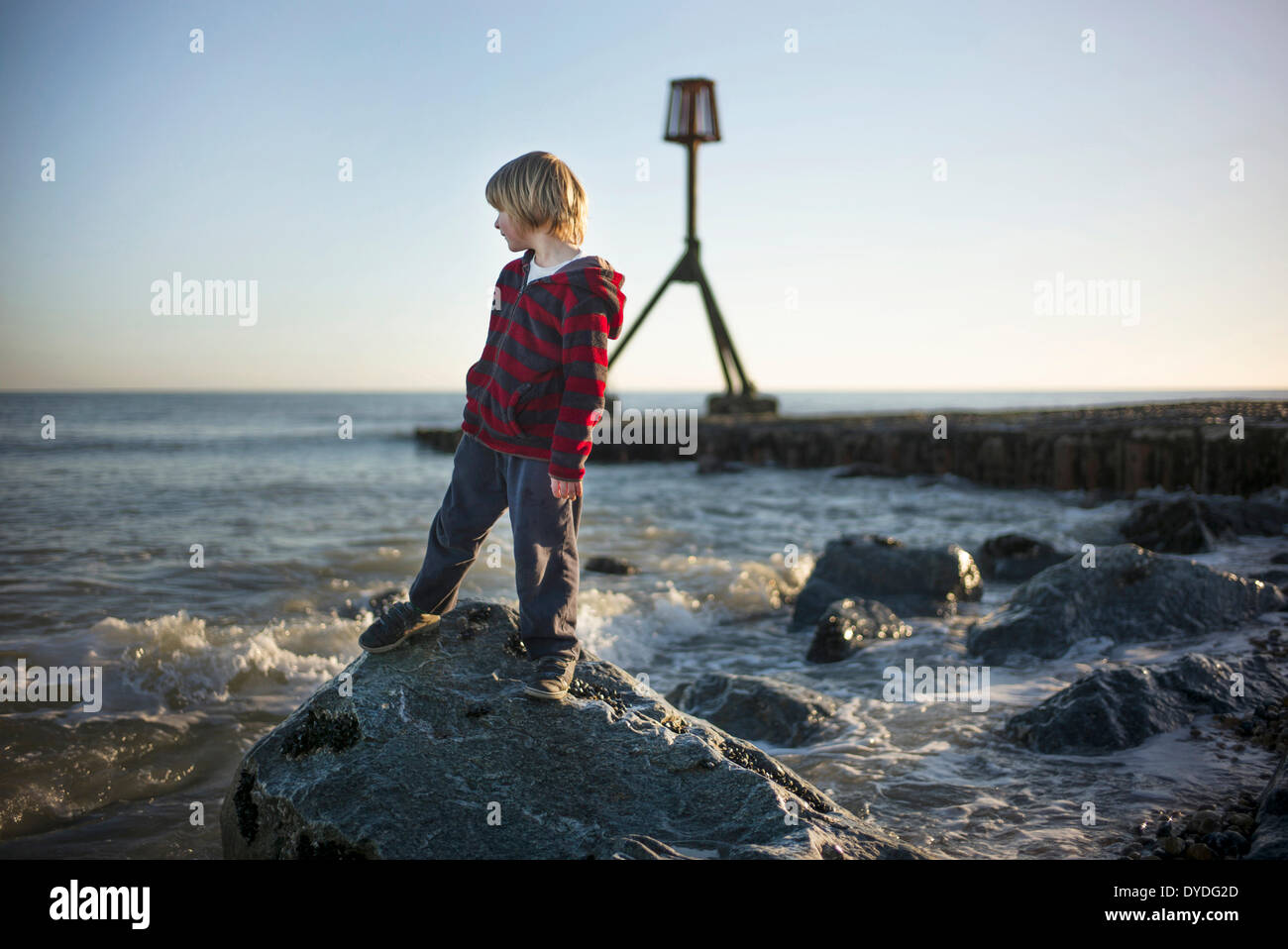 Playing by the sea in spring time. - Stock Image