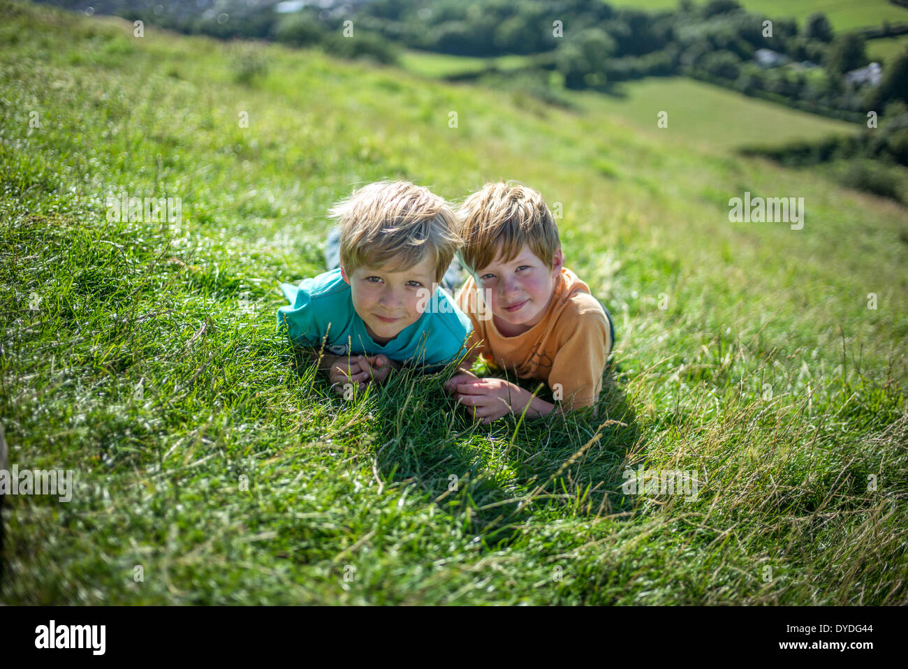 Two boys at the top of Glastonbury Tor. - Stock Image