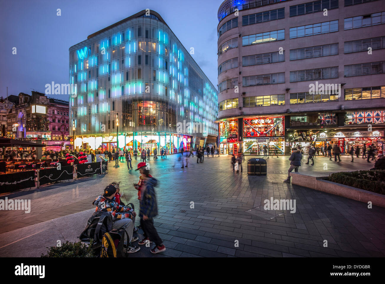 Leicester Square at dusk and the W Hotel. - Stock Image