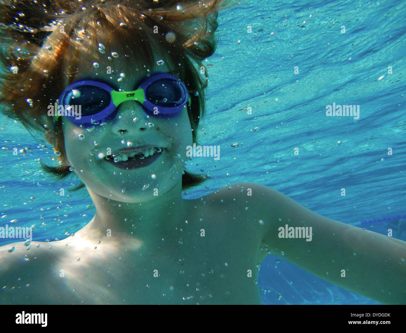 Seven year old boy underwater. - Stock Image