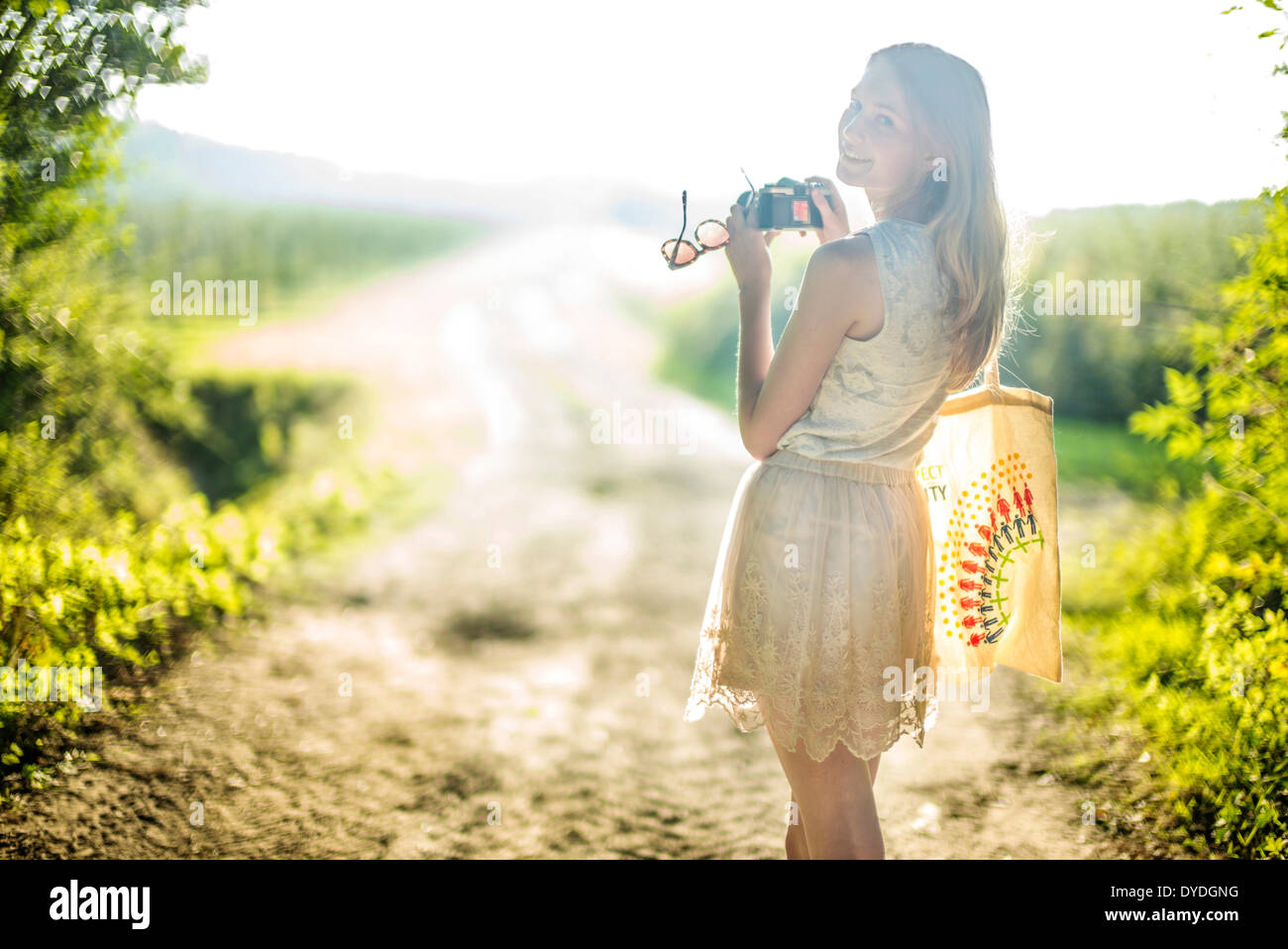 A young girl with a film camera. - Stock Image