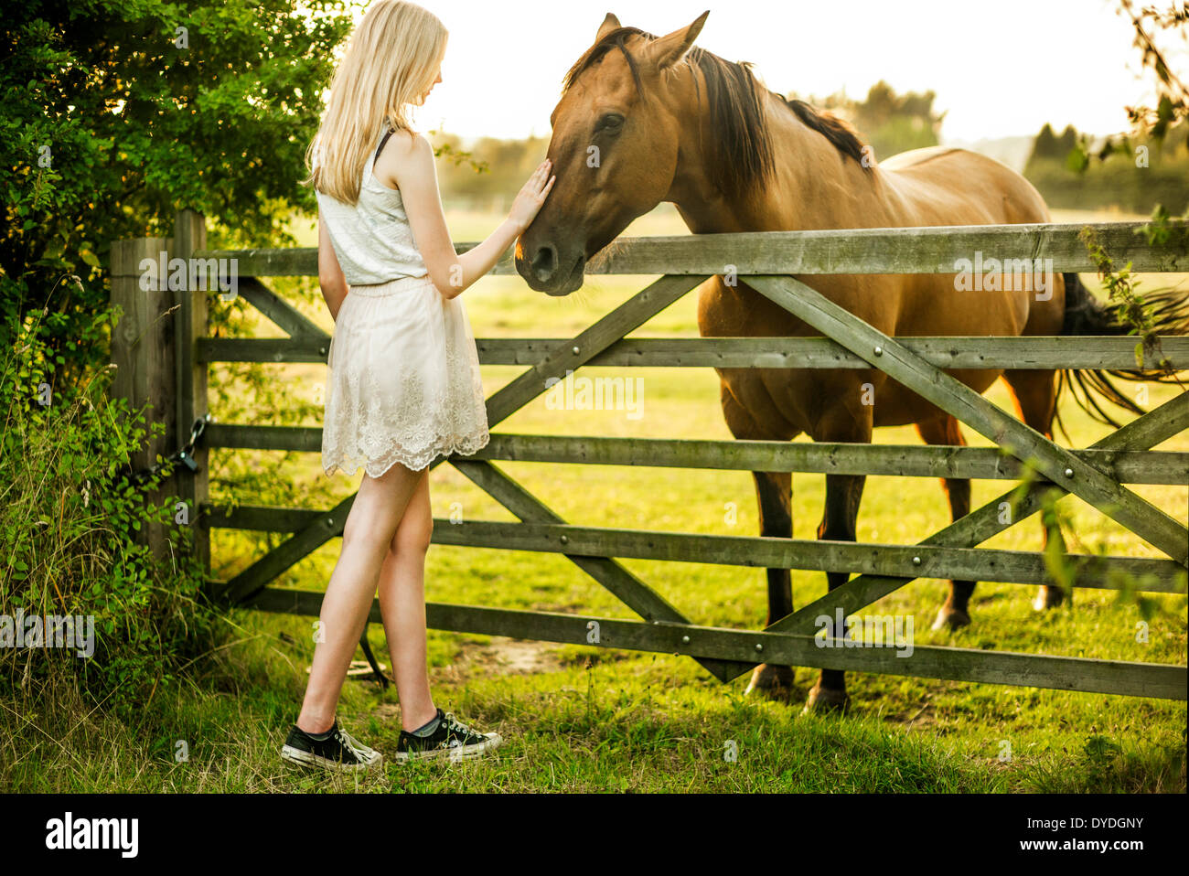 A 15 year old girl with a horse. - Stock Image