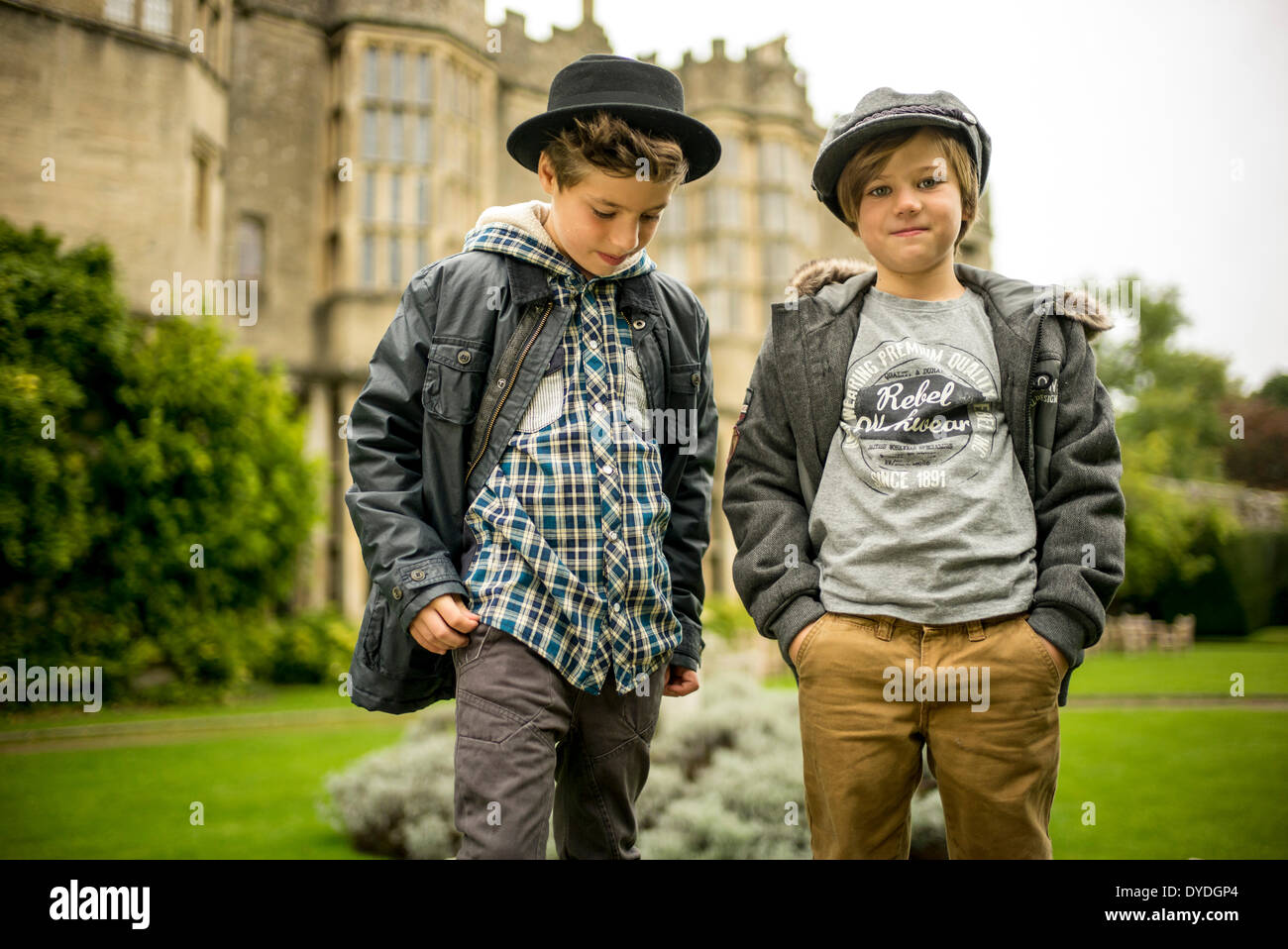 Two young boys outside Thornbury Castle. - Stock Image
