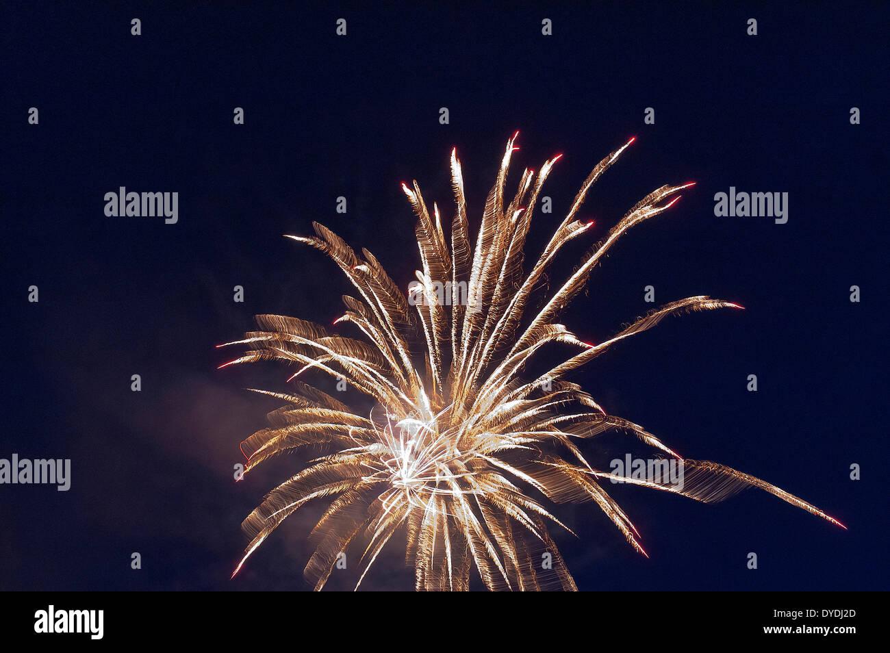 Fire, fireworks, pyrotechnics, rocket, rays, beams, explode, explosion, sky, night, - Stock Image