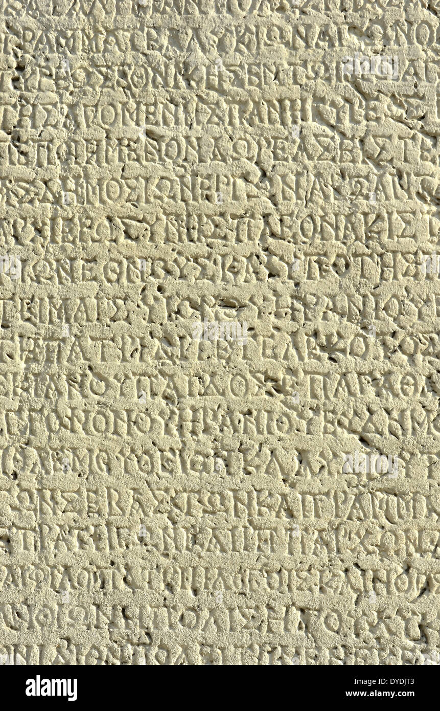 Greek ancient Greek Greek letters language classic classical alphabet writing engraving engraved tablet stone dedication ston - Stock Image