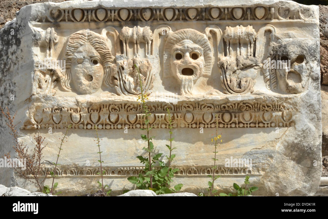 Greek masks mask theatre acting play theatrical disguise comedian Greek tragedy face hide chorus actor actress marble ancie - Stock Image