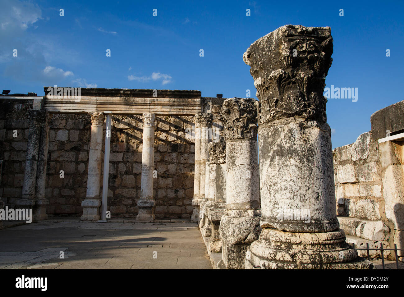 Ruins of the old synagogue in Capernaum by the Sea of Galilee, Israel. - Stock Image
