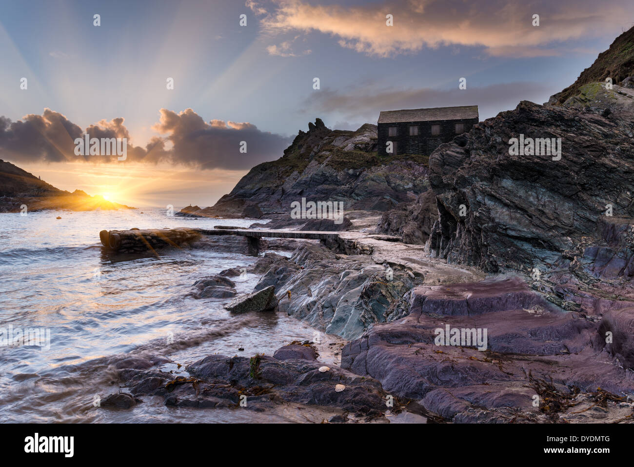 The beach at Polperro a small historic fishing village on the south coast of Cornwall - Stock Image
